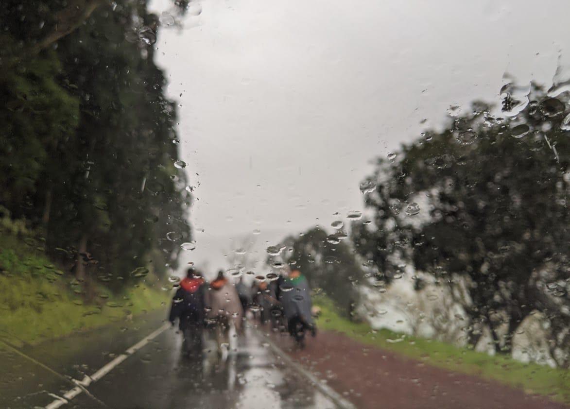 Playground Earth | The Romeiros Under Rain